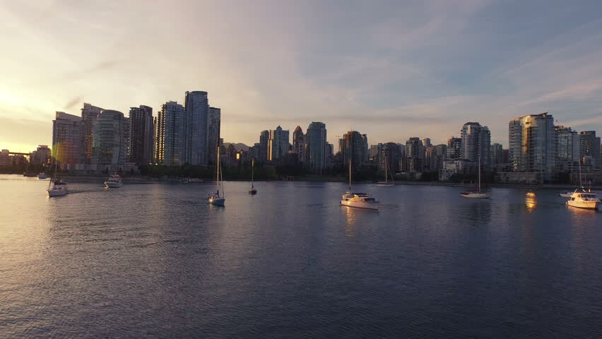 4K forward Aerial drone shot of Vancouver skyline at sunset.
