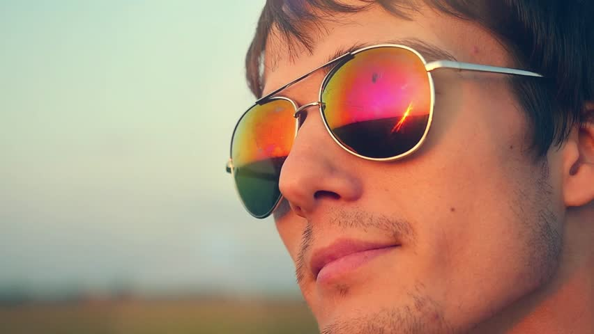 Wearing Sunglasses Pictures  reflection of sunset in sunglasses free stock video footage