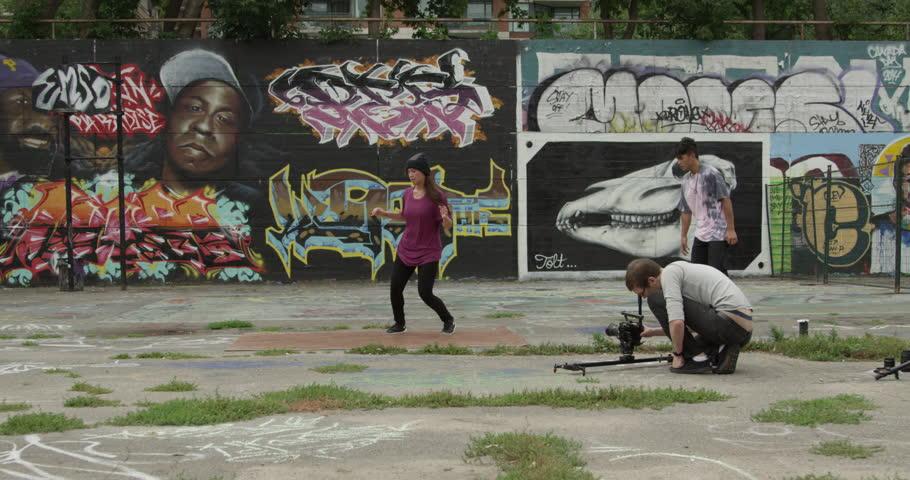Toronto, Canada - August 2015 - A female professional break dancer performing an urban art routine - 4K stock video clip