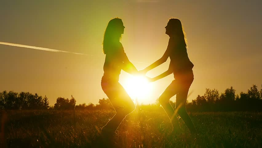 Two friends, young girls enjoy nature running, jumping, dancing in fields on sunset. Slow motion. - HD stock video clip