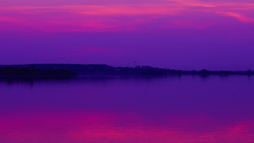 Pink sunset over lake,pan, time lapse - 4K stock video clip