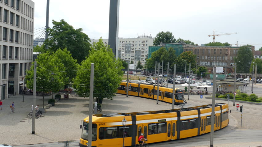 DRESDEN, GERMANY - JULY 2015: Trams on the street of Dresden, Germany. City life