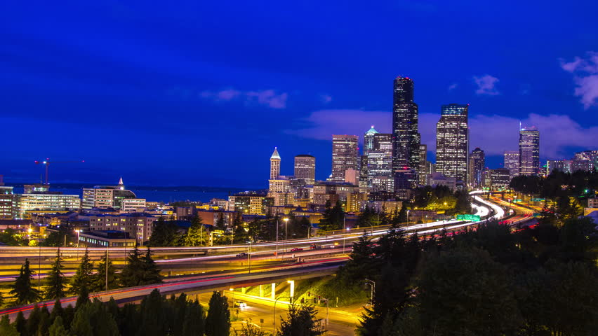 Twilight Freeway Traffic Time Lapse in Seattle, WA, USA. High impact busy traffic on highway 5 going on both direction at night.