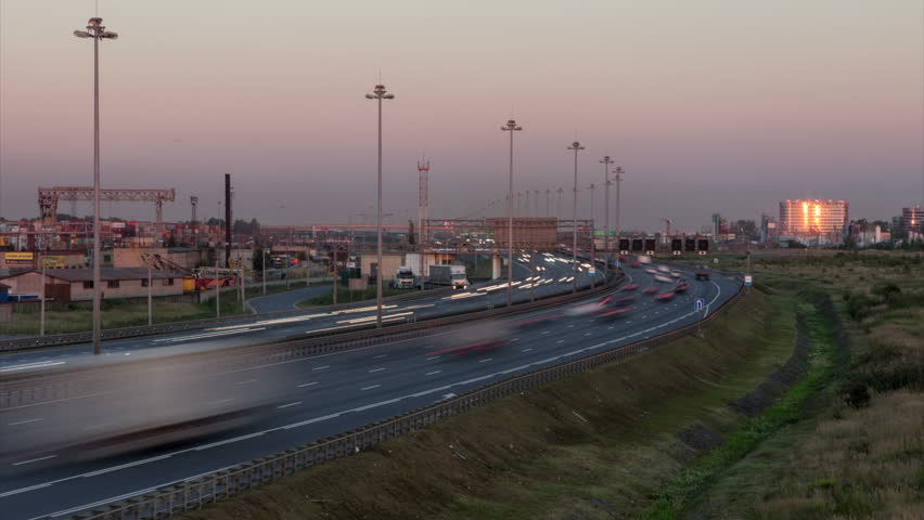 Cars driving at circular highway of St. Petersburg city, Russia. Setting sun - 4K stock video clip