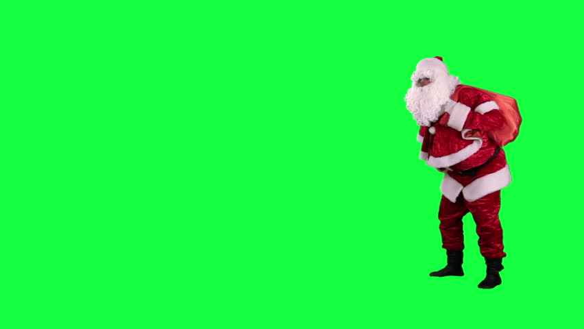 Santa Claus with gift bag chroma key (green screen). Santa is on tiptoe with gift bag isolated on green