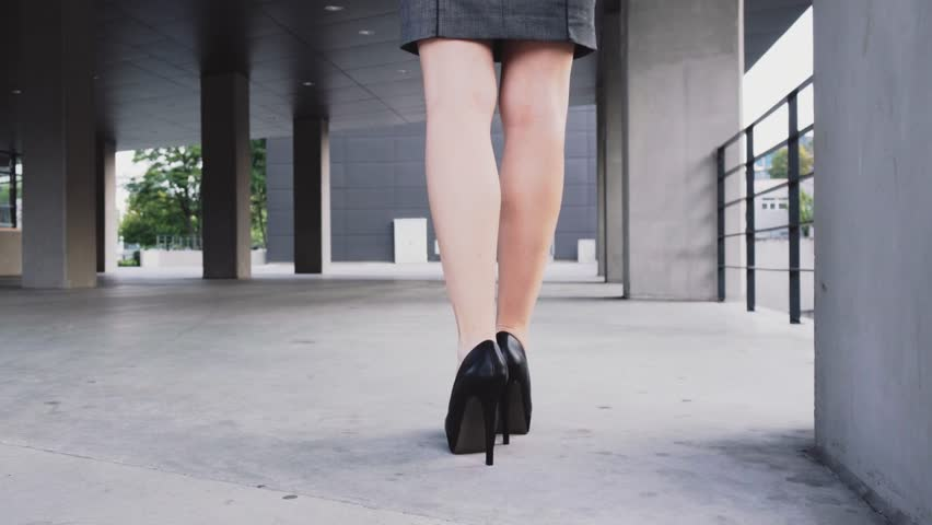 Sexy woman legs in black high heels shoes walking in the city urban street. Steadicam stabilized shot. Businesswoman Female legs in high-heeled shoes in the morning. Cinematic shot.   Shutterstock HD Video #11926556