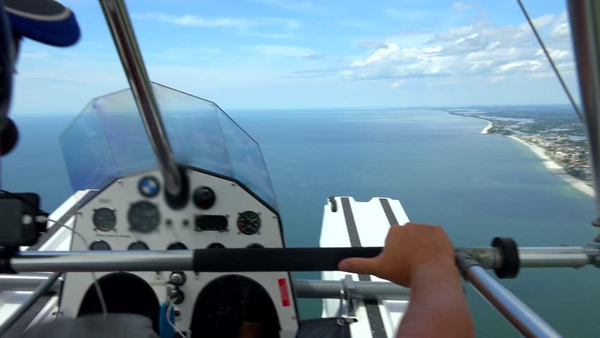 Seaplane, open cockpit flying in Florida, Gulf Coast area. - 4K stock video clip