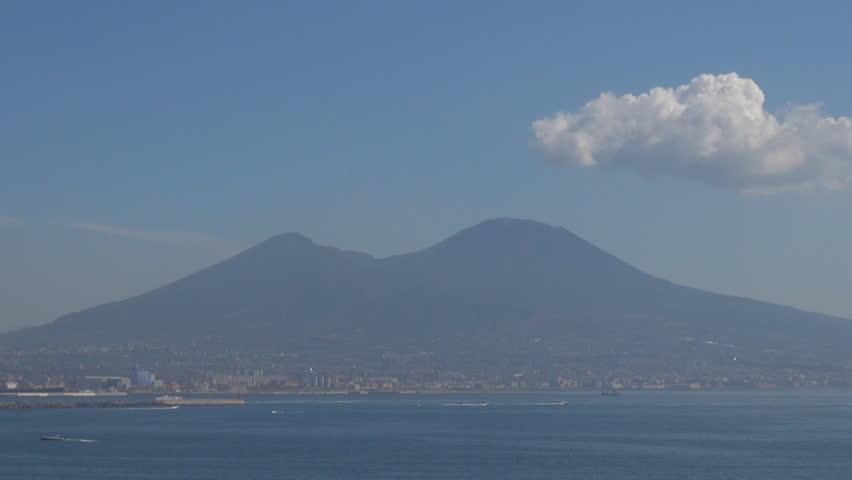 Aerial view of Naples landmark of Mount Vesuvio, Mountain Vesuvius and bay boat by day - HD stock video clip