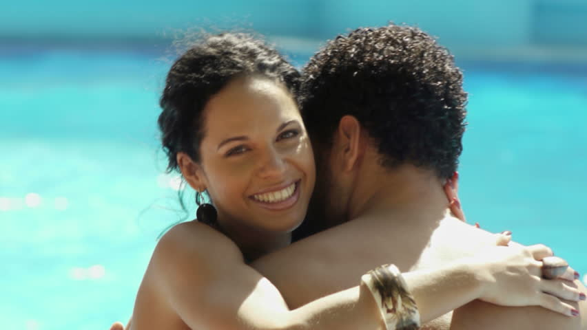 Honeymoon and people, happy young newlyweds smiling and relaxing near hotel swimming pool, husband and wife on vacation, boyfriend and girlfriend during holidays - HD stock footage clip