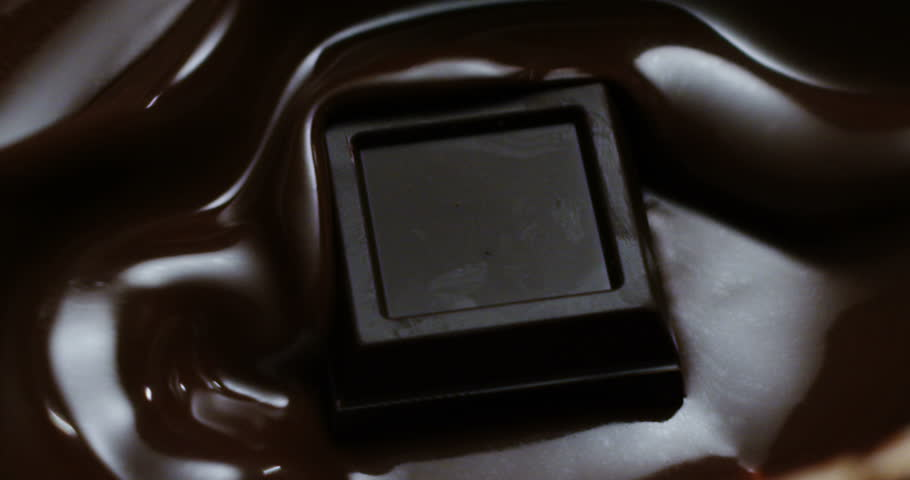 Super slow motion of hot chocolate drop failing whipping sauce on a restaurant kitchen in 4k (macro close up) | Shutterstock HD Video #11994236