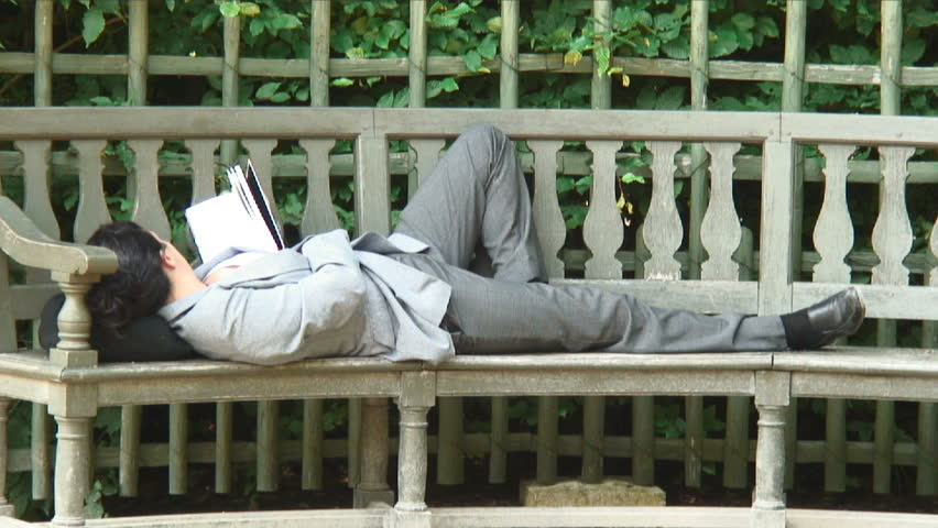 France - October, 2012: Women reading/resting on a bench in Paris | Shutterstock HD Video #11997665