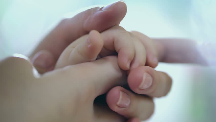 Concept of love and family. hands of mother and baby closeup, Hand in hand. Mother care. Caring mother with baby, Playing with baby. Slow Motion. - HD stock video clip