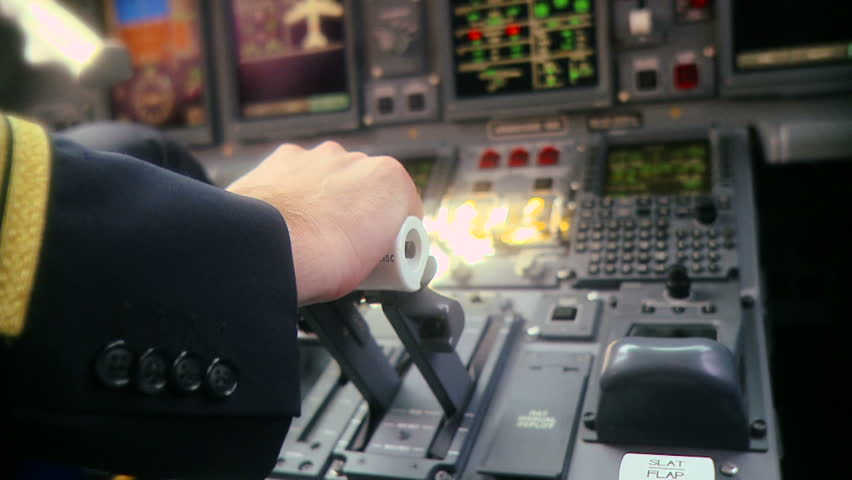 Hand of pilot push thrust lever handle for plane engine control takeoff slow motion