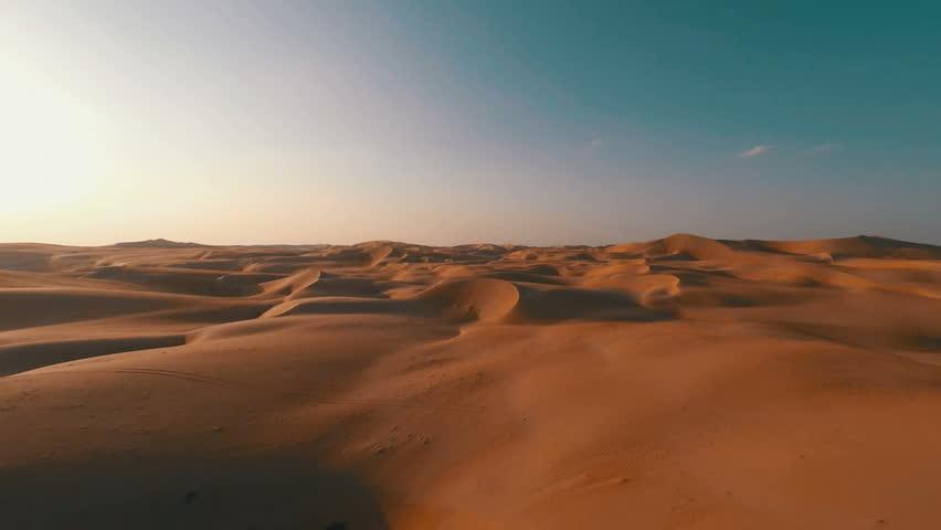 Flying backwards over picturesque sand dunes in the Arabian desert | Shutterstock HD Video #12046013