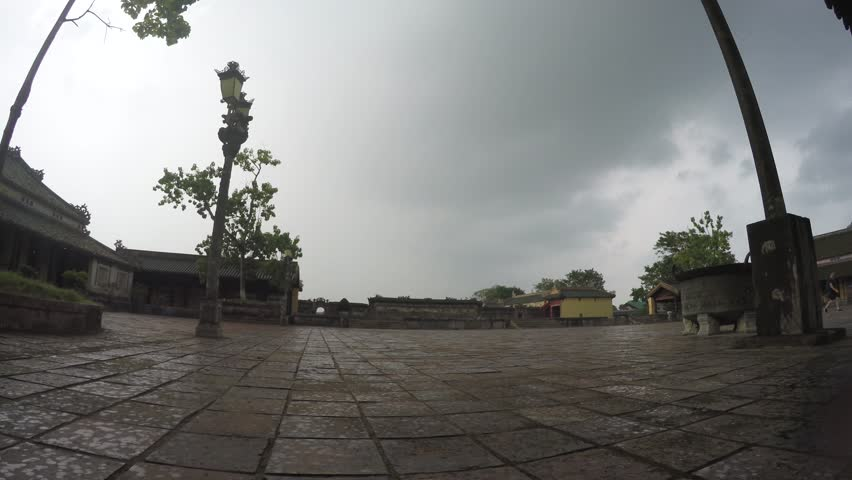 Hue, Vietnam - October 2, 2015 - Static footage of starting rain on one of the squares in Imperial City Citadel (Kinh Thanh Hue) is a walled fortress and palace in the city of Hue central vietnam 4k | Shutterstock HD Video #12058298