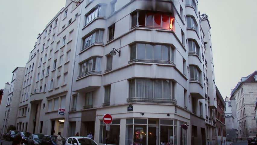 Third floor apartment on fire after explosion - frontal shoot. 4 OCTOBER 2015 - PARIS, FRANCE; An apartment explodes and catches fire, breaking all the windows and killing one person.