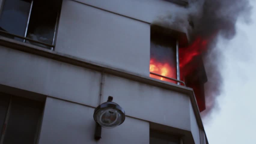 Close shoot of window in flames in Parisian apartment. 4 OCTOBER 2015 - PARIS, FRANCE; An apartment explodes and catches fire, breaking all the windows and killing one person.