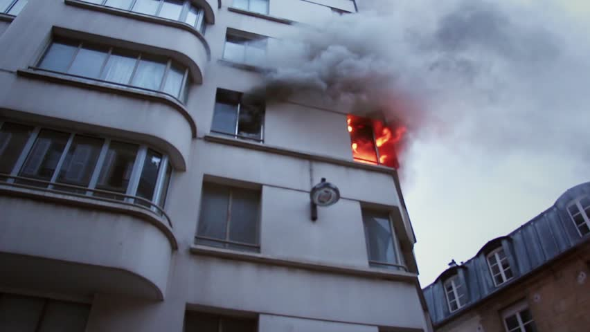 Explosion in apartment creates a huge fire - low angle shoot. 4 OCTOBER 2015 - PARIS, FRANCE; An apartment explodes and catches fire, breaking all the windows and killing one person.