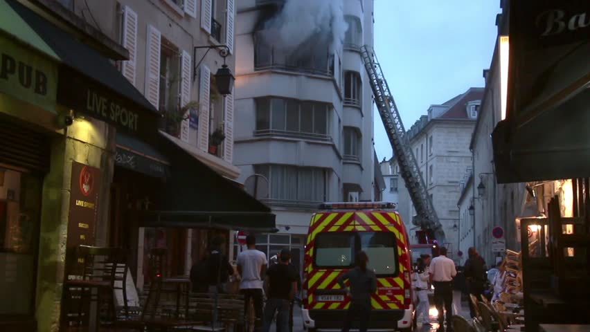 Firefighters combating fire in central Paris. 4 OCTOBER 2015; PARIS, FRANCE. An apartment explodes and catches fire, breaking all the windows and killing one person.