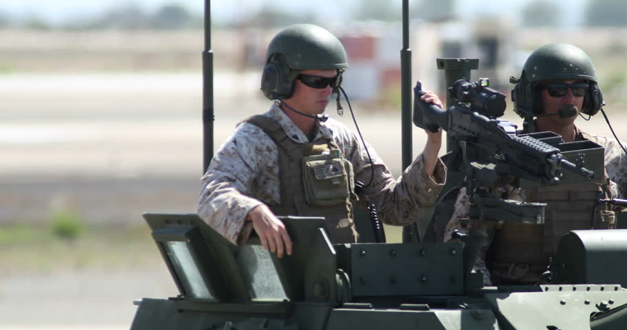 MIRAMAR, CA - OCT 3: Marines in an Stryker Armored Fighting Vehicle wave to the crowd during the Marine Air-Ground Task Force (MAGTF) demonstration at the airshow in Miramar, CA on Oct 3, 2015.