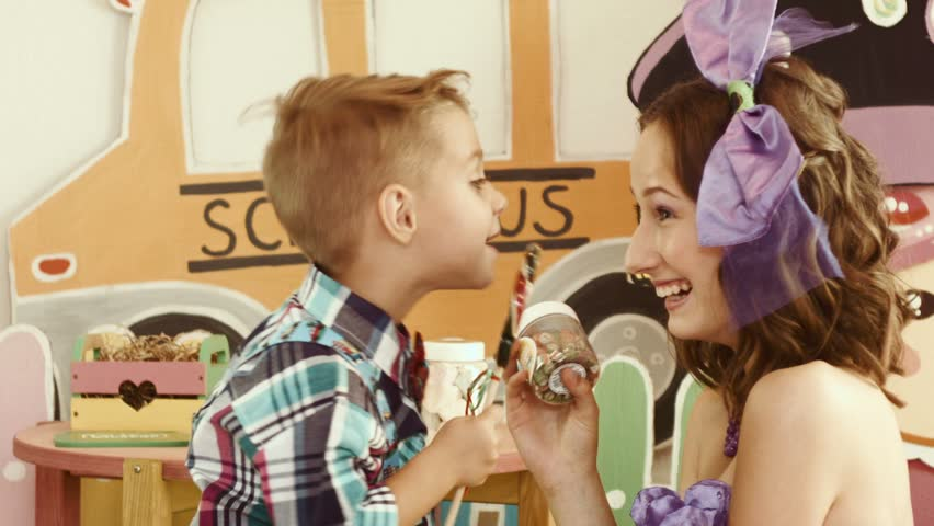 The boy and the teenage girl lick candy   Shutterstock HD Video #12123125
