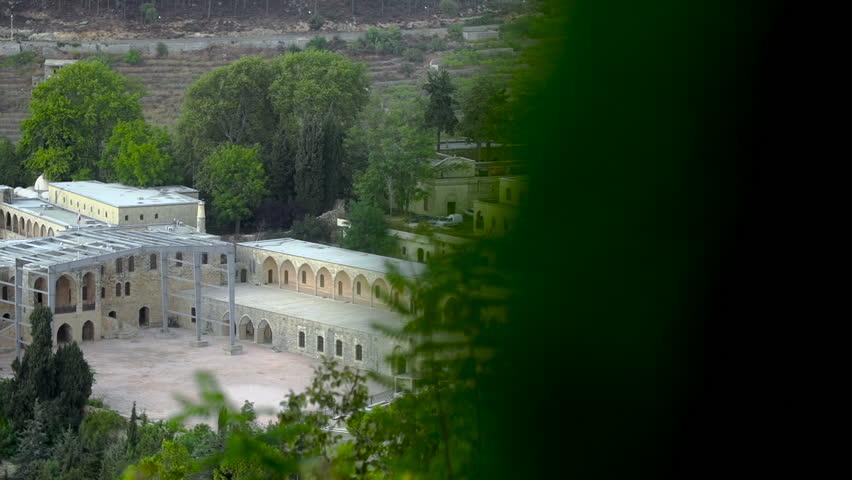 Pan left toBeiteddine Palace, close. Beiteddine Palaceis a 19th-century palace in Beiteddine, Lebanon, which hosts the annual Beiteddine Festival and the Beiteddine Palace Museum