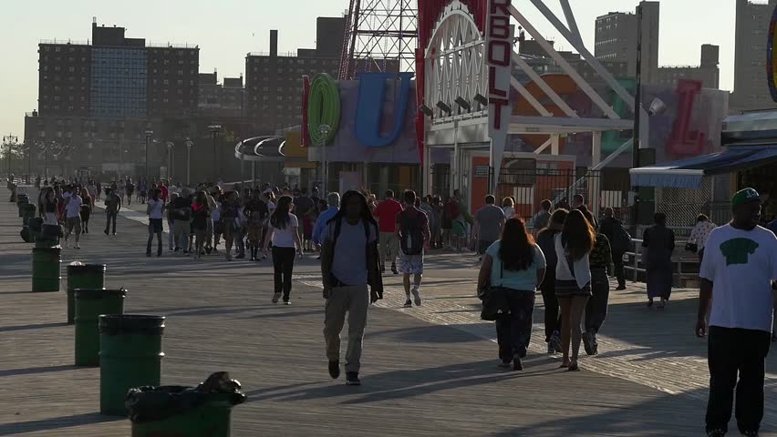 NEW YORK - CIRCA JULY, 2015: people walking on Coney island boardwalk circa July 2015 in Brooklyn, New York. - HD stock footage clip