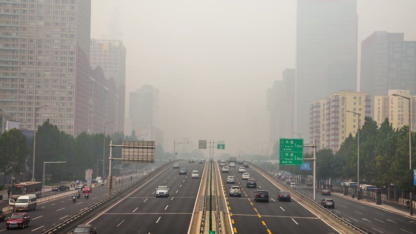 China's capital city of Beijing street traffic of automobiles. Foggy day, smog, air pollution. | Shutterstock HD Video #12197852