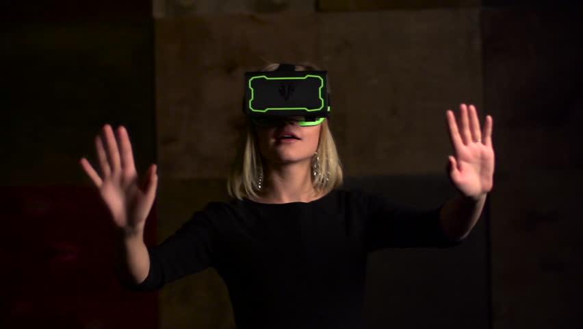 Virtual reality game. Girl uses head mounted display. Slow motion