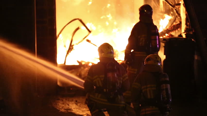 Quebec, Canada - August 2015 - Spectacular house fire, firemen use hose.
