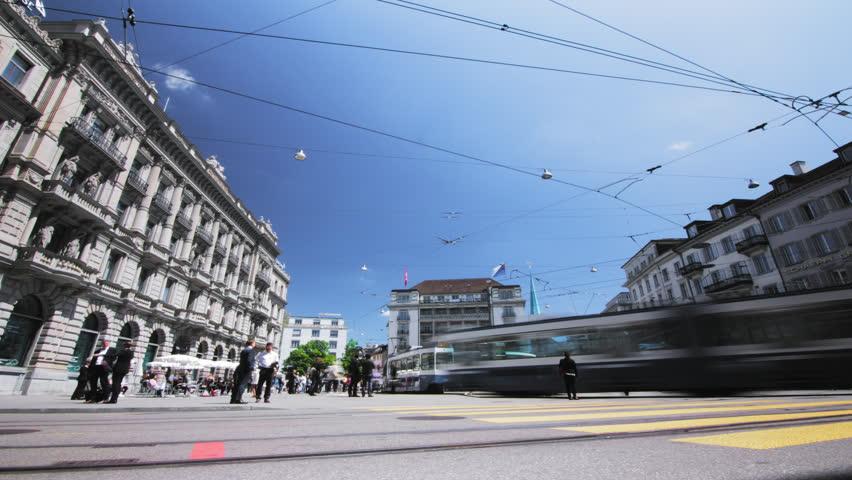 4K Timelapse Zurich Paradeplatz - Swiss banks - Pedestrian & Blue Trams / Time lapse of trafic crossing in Zurich Switzerland - dynamic European city