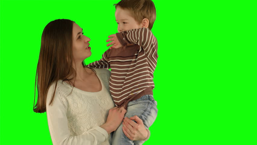Happy family having fun.  on a Green Screen, Chroma Key. Professional shot on BMCC RAW with high dynamic range. You can use it e.g in your commercial video, family video, music video. | Shutterstock HD Video #12221909