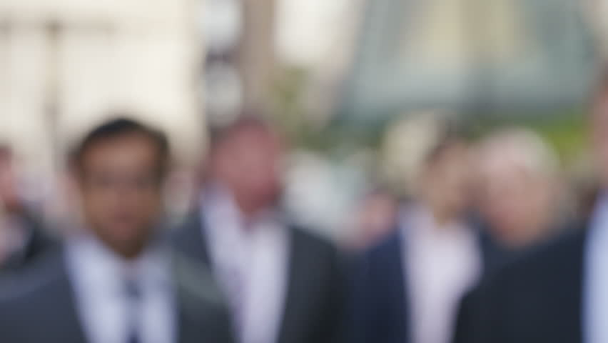4K Blurred business workers in the city walking towards camera, shot on Red Epic Dragon