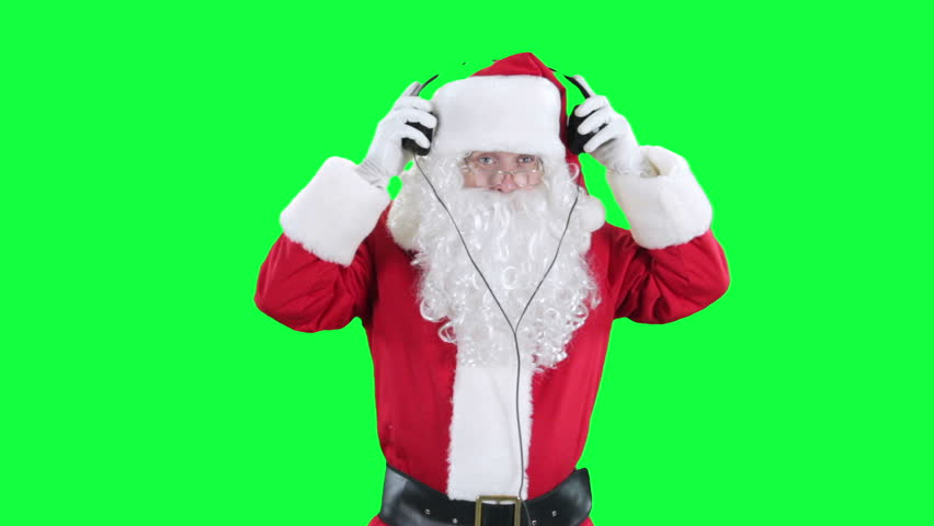 Santa Claus in headphones chroma key (green screen). Santa listens to music through headphones isolated on green
