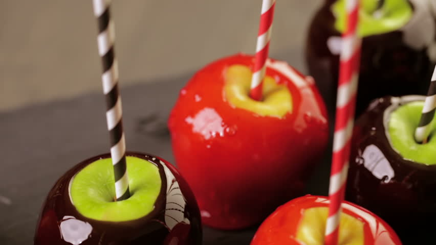 Handmade red candy apples for Halloween. | Shutterstock HD Video #12259772