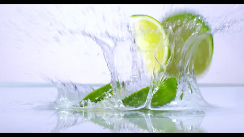 Lime splashing into water in slow motion
