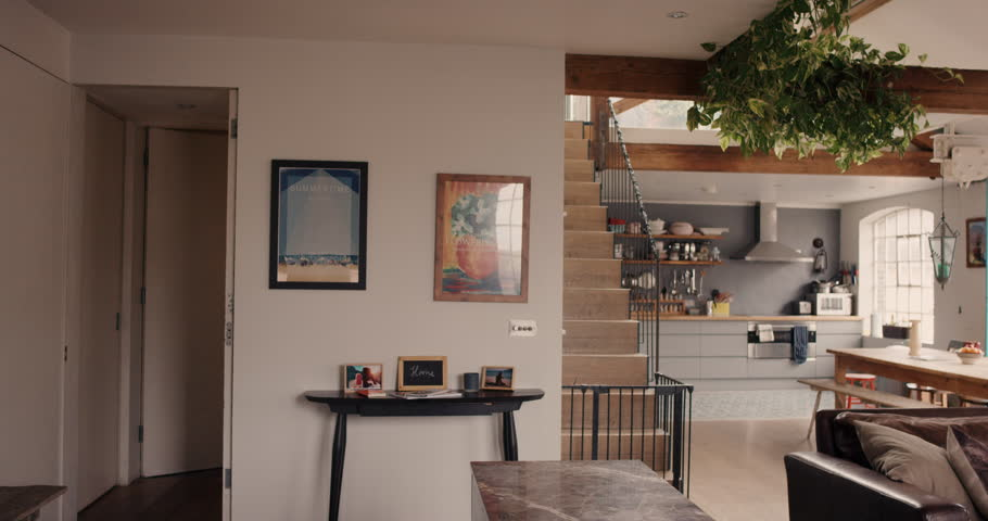 Happy couple walk into their dream home and embrace slow motion steadicam shot #12273461