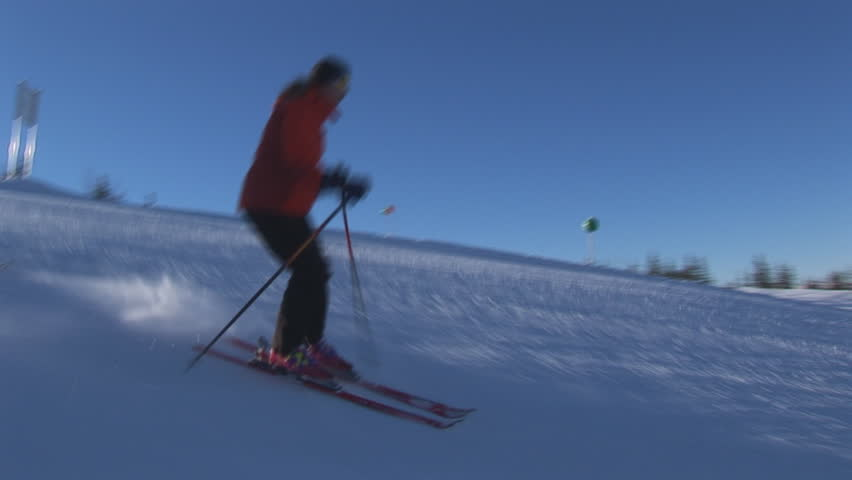 two skiers on flat slope