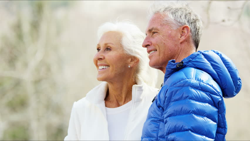 Portrait Caucasian retirement male female older couple freedom confidence medical tourism fitness active walking winter travel RED DRAGON   Shutterstock HD Video #12331052