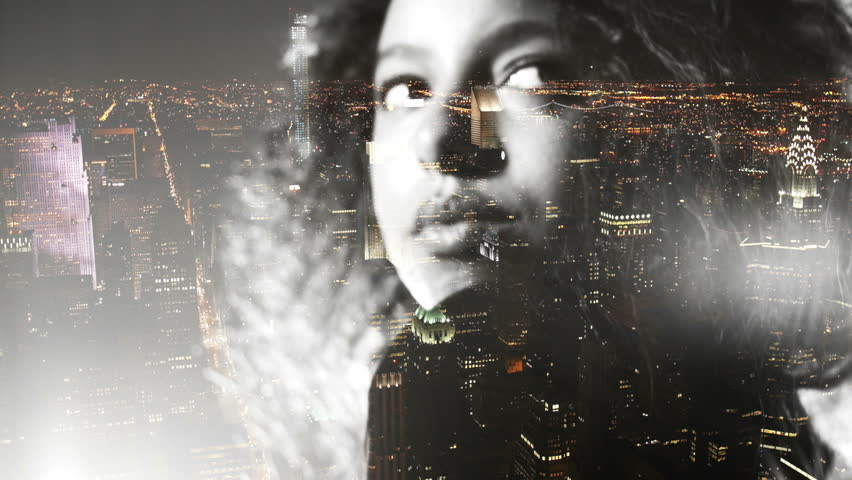 Afro girl double exposed over new york at night with city lights