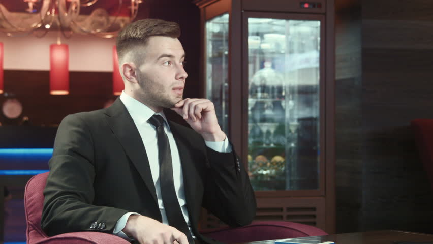 Businessman waiting for meeting and nervous | Shutterstock HD Video #12385178