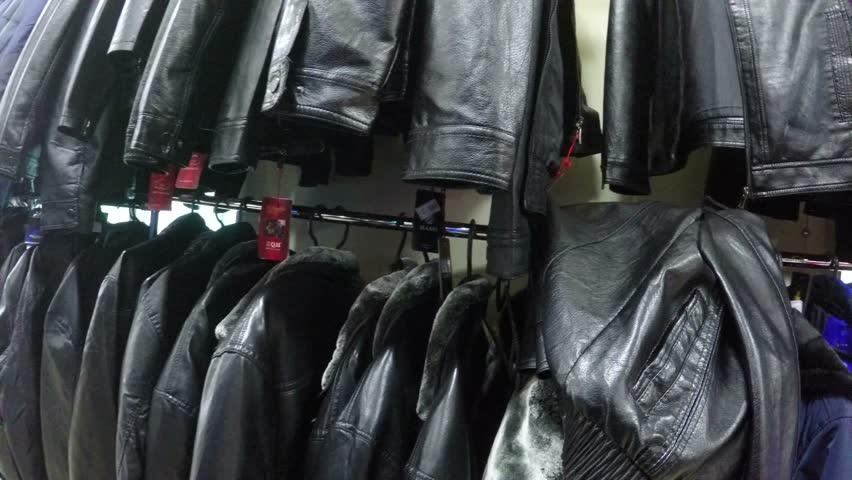 First-person  man view jacket chooses winter coat in shop market   Shutterstock HD Video #12392729