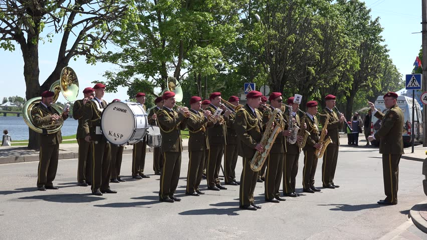 SIRVINTOS, LITHUANIA - JUNE 29: Military army orchestra band play various instruments with leader during city anniversary celebration on June 29, 2015 in Sirvintos, Lithuania. Static shot. 4K - 4K stock video clip
