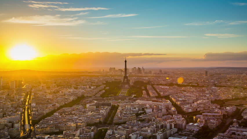 Paris - August 3rd, 2013: Time lapse footage of sunset over Eiffel Tower seen from Tour Montparnasse (Montparnasse 56), Paris, France | Shutterstock HD Video #12433112
