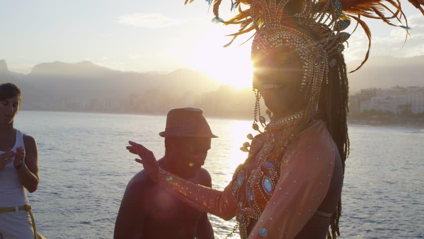 Woman dressed in carnival costume dancing
