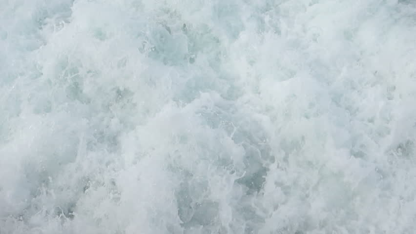 Sea water splashes at the back of a boat, halfway slowed down from 50p to 25p - HD stock footage clip