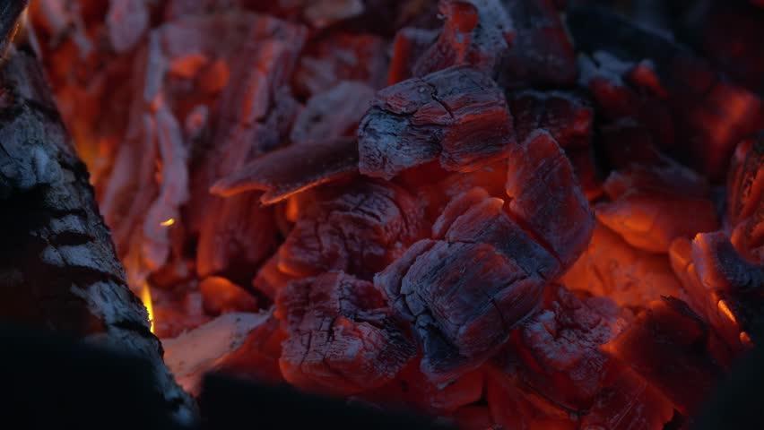 Fiery campfire embers - 4K stock footage clip