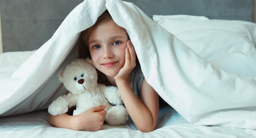 Portrait Girl Child Hugging Teddy Bear In A Bed Top View