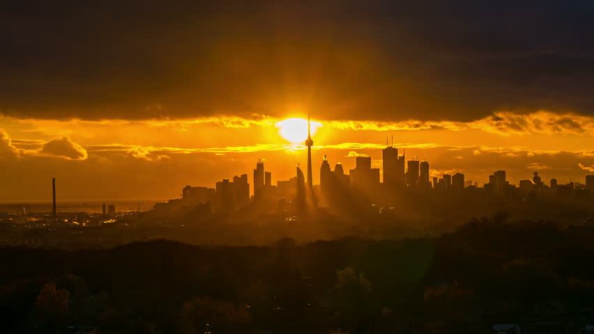 Toronto Skyline City Sunset time lapse 4k 1080 - Time lapse of the sun setting behind the city of Toronto Canada