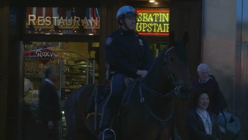 NYC Cop and horse next to neon lights. New York, USA. 2010 | Shutterstock HD Video #12506201